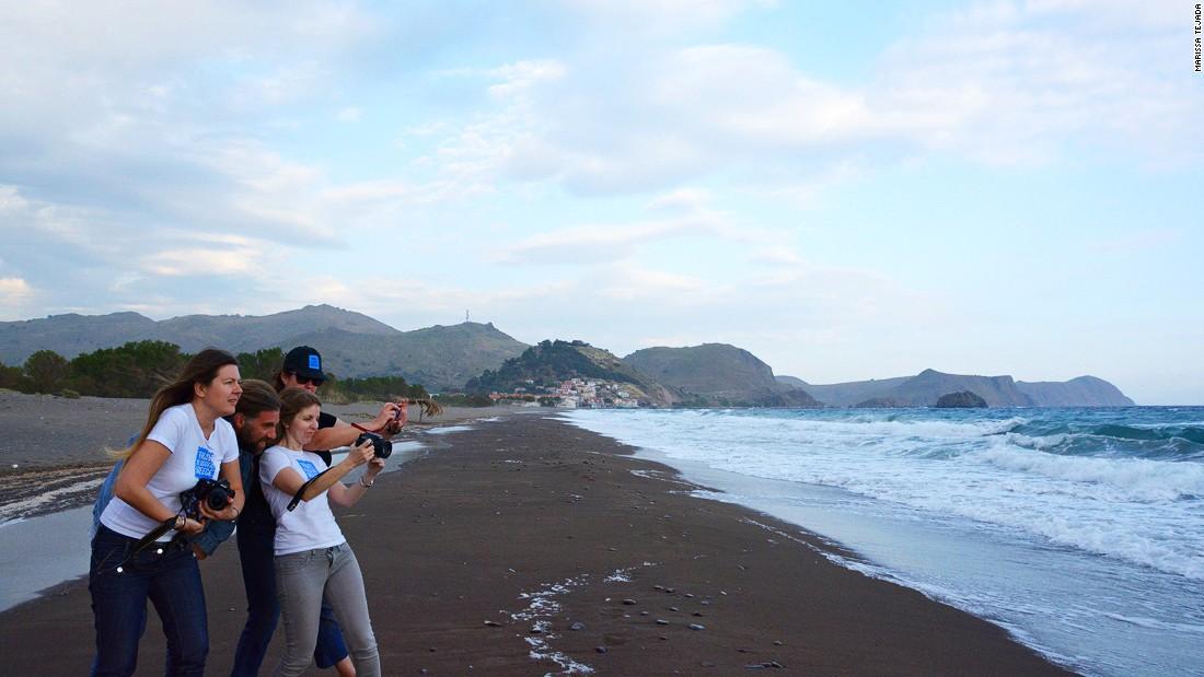 Local business owner Yiorgos Eleftheriou shows off a stretch of Skala Eressos beach to Travel Bloggers Greece members Elena Sergeeva, Chrysoula Manika and Amber Charmei.