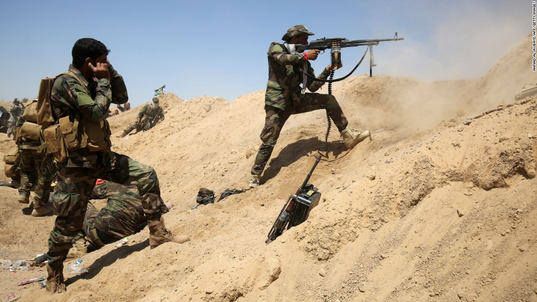 Iraqi government forces engage with ISIS fighters near the village of al-Sejar on Thursday, May 26.