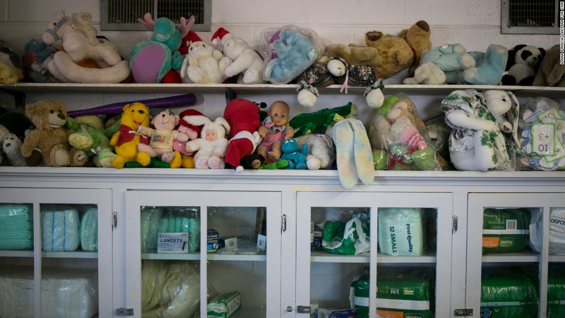 """At Ysleta Lutheran Mission's thrift store, Cubans can pick up whatever they need for free while they stay at the shelter. The Rev. Karl Heimer, the mission's director, is Cuban and says he's happy to help people from his country. """"These are people who are professionals,"""" he says, """"and they will add to our society."""""""