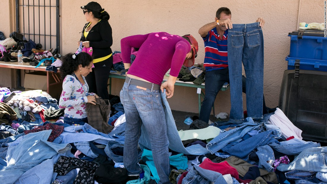 Piles of donated clothes are popular with Cubans who've just arrived at the Houchen Community Center. Many say their belongings were stolen as they traveled from Ecuador through Colombia and into Panama.