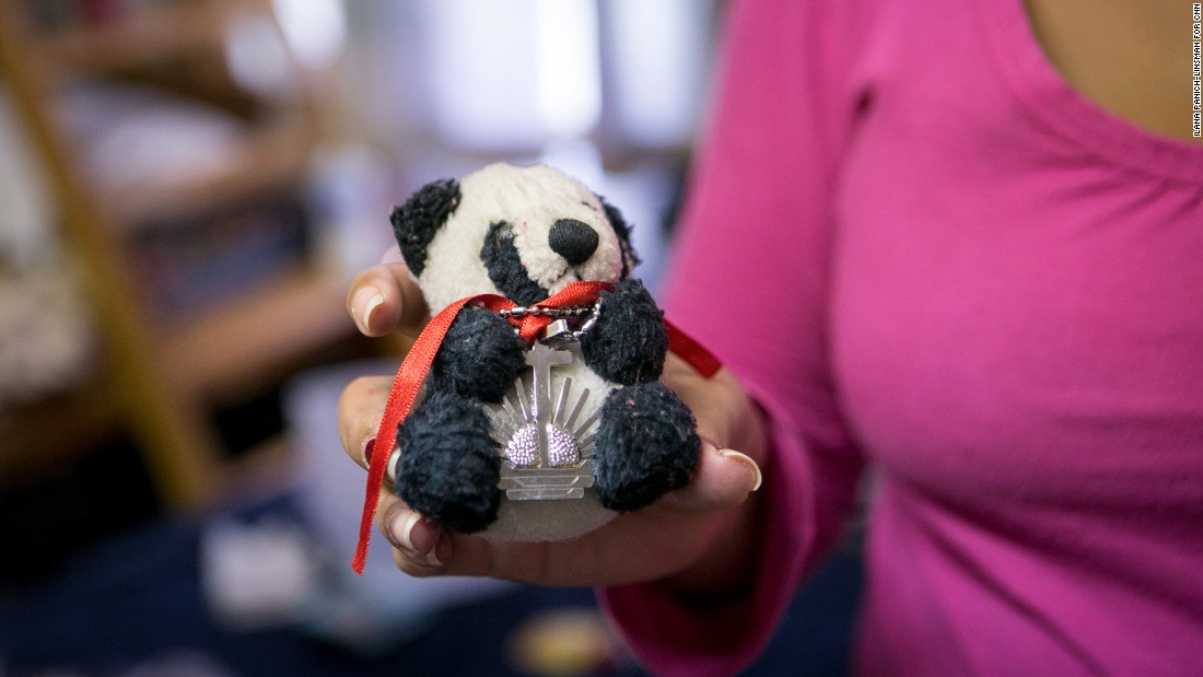"""When she gave me the bear, she told me she would always be with me,"" Yadira Lozano Odio, 31, said, her eyes welling up with tears as she described the moment she said goodbye to her best friend in Santiago de Cuba. Lozano keeps a necklace wrapped around the small stuffed panda -- a gift from another close friend. The necklace, she said, was blessed by a priest in her friend's church."