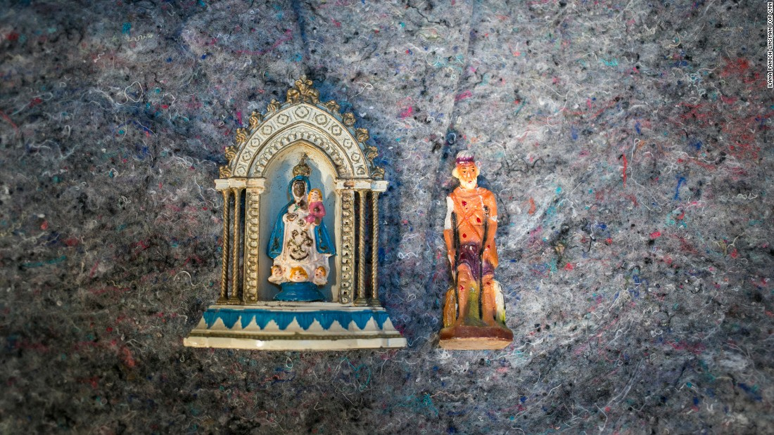 "Wrapped in clothes in a backpack he carried from Ecuador to the United States, Julio Cesar Valle Hernandez keeps small statues of the Virgen de la Regla (Our Lady of Regla) and San Lazaro (Saint Lazarus). ""It got broken on the way,"" he said, ""but I couldn't leave it behind."""