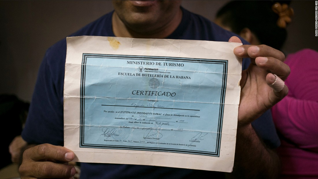 Edgardo Nuñez Cobas, 43, used to work as a cook at a five-star hotel in Cuba. He brought a certificate that shows his hospitality training with him to the United States and hopes it will help him land a job. For now, days after he arrived in America, he's cooking food at a shelter where Cubans who've just crossed into the United States are staying in El Paso, Texas.