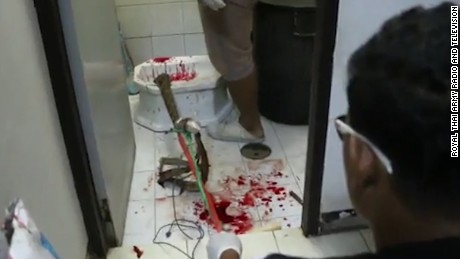 Blood is splattered across the bathroom floor where the man was bitten by the python.