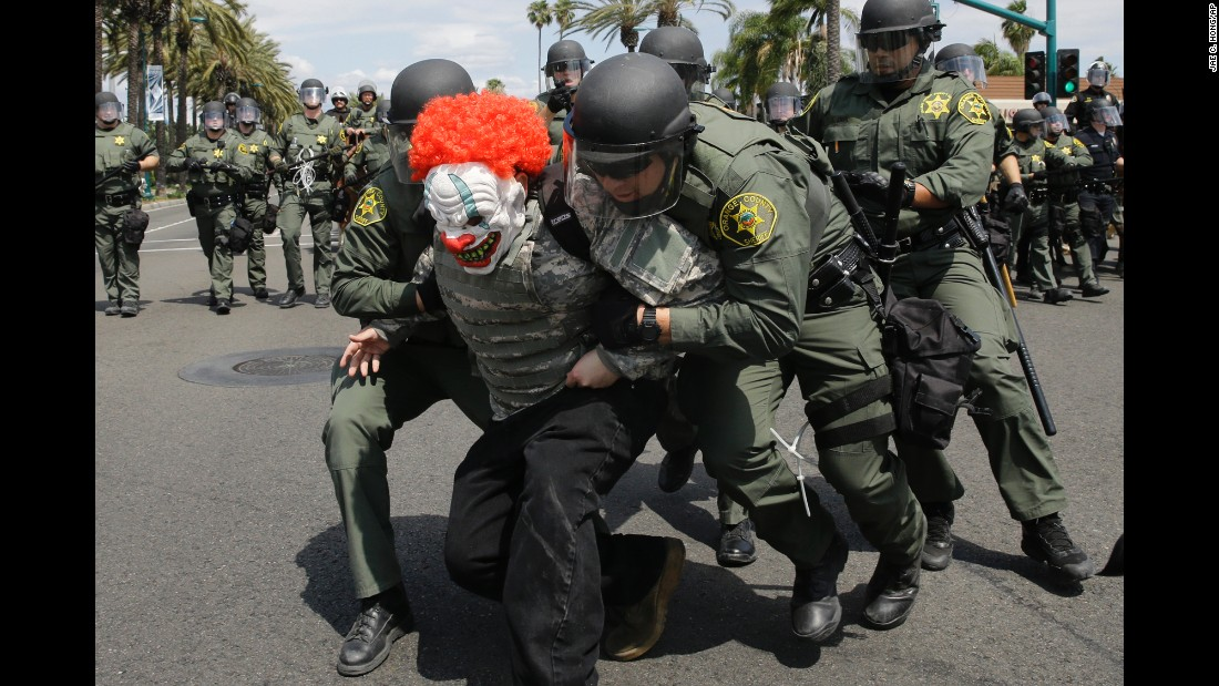 Sheriff's deputies arrest a protester near the convention center in Anaheim, California, on Wednesday, May 25. Republican presidential candidate Donald Trump was holding a rally at the convention center.