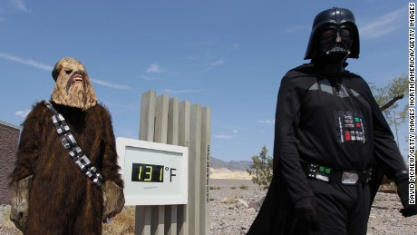 DEATH VALLEY NATIONAL PARK, CA - JUNE 30:  Randy Kern (L) and John Rice dress as Star Wars characters for their own annual snapshot tradition near an unofficial thermometer at Furnace Creek Visitors Center reading of 131 degrees, believed by officials to be about three degree on the high side, as a heat wave spreads across the American West on June 30, 2013 in Death Valley National Park, California. Weather forecasters predict that high temperatures could reach 130 degrees in Death Valley today and tomorrow, breaking the hottest-ever temperature for June of 128 degrees, set on June 29, 1994. It is also just four degrees shy of breaking the all-time world record of 134 degrees which occurred here 100 years ago on July 10, 2013. Since then, the 130-degree mark has never been repeated and the 129-degree mark has occurred on only four occasions. Formerly, it was thought that the world?s highest temperature occurred in El Azizia, Libya in 1922 but an international team of climate experts from the World Meteorological Organization (WMO) declared that reading invalid because of the combination of poor weather instrumentation which was operated by an inexperienced record-keeper located in a bad spot for accurate readings.  (Photo by David McNew/Getty Images)