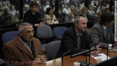 "Former Argentine intelligence agent Miguel Angel Furci (L) gestures as he waits to hear the sentence to be handed down by the court in the trial on Operation Condor, in which six South American dictatorships collaborated to torture and kill their opponents, in Buenos Aires on May 27, 2016. South American ex-military leaders faced judgment Friday for their alleged role in the torture and assassination of leftist dissidents during a US-backed crackdown by the region's dictatorships during the 1970s and 1980s. Argentine judges were considering their verdict in the trial of 18 former army officers accused of taking part in ""Operation Condor."" In that scheme, the military regimes of Argentina, Bolivia, Brazil, Chile, Paraguay and Uruguay helped each other track down and kill leftist dissidents.  On Friday, the court convened to deliver its verdict after a three-year trial -- the first to try the crimes committed under the Condor plan / AFP / JUAN MABROMATA        (Photo credit should read JUAN MABROMATA/AFP/Getty Images)"