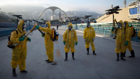 FILE - In this Tuesday, Jan. 26, 2016  file photo, health workers get ready to spray insecticide to combat the Aedes aegypti mosquitoes that transmits the Zika virus, under the bleachers of the  in Rio de Janeiro, which will be used for the Archery competition in the 2016 summer games. More than 145 public health experts signed an open letter to the World Health Organization on Friday, May 27, 2016 asking the U.N. health agency to consider whether the Rio de Janeiro Olympics should be postponed or moved because of the ongoing Zika outbreak. The letter calls for the games to be delayed or relocated in the name of public health. (AP Photo/Leo Correa, File)