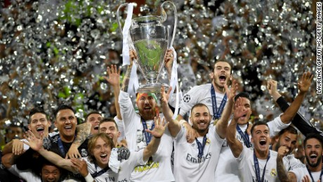 Real Madrid won it's 11th UEFA Champions League Final match against Atletico Milan on May 28. Regulation time ended with a 1:1 tie but Real Madrid won 5-3 on penalty kicks. Sergio Ramos lifts the Champions League trophy as his teammates celebrate around him.