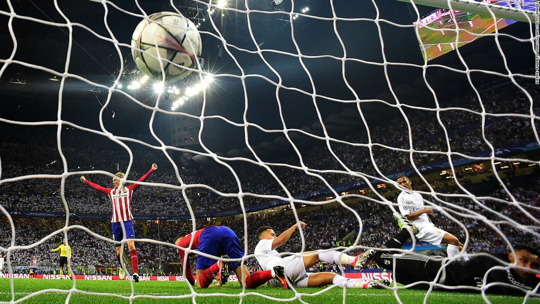The ball hits the net as Atletico Madrid forward Yannick Carrasco scores the first goal during the UEFA Champions League final football match.