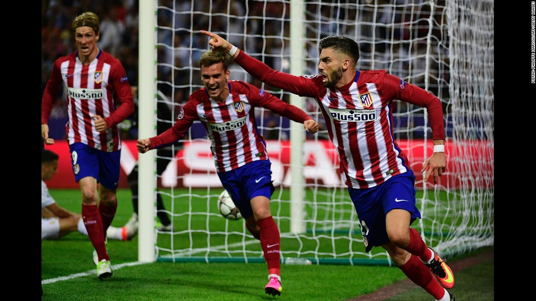 Atletico Madrid forward Yannick Carrasco celebrates after scoring.