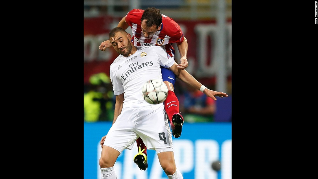 Atletico's Diego Godin challenges Real Madrid's Karim Benzema.