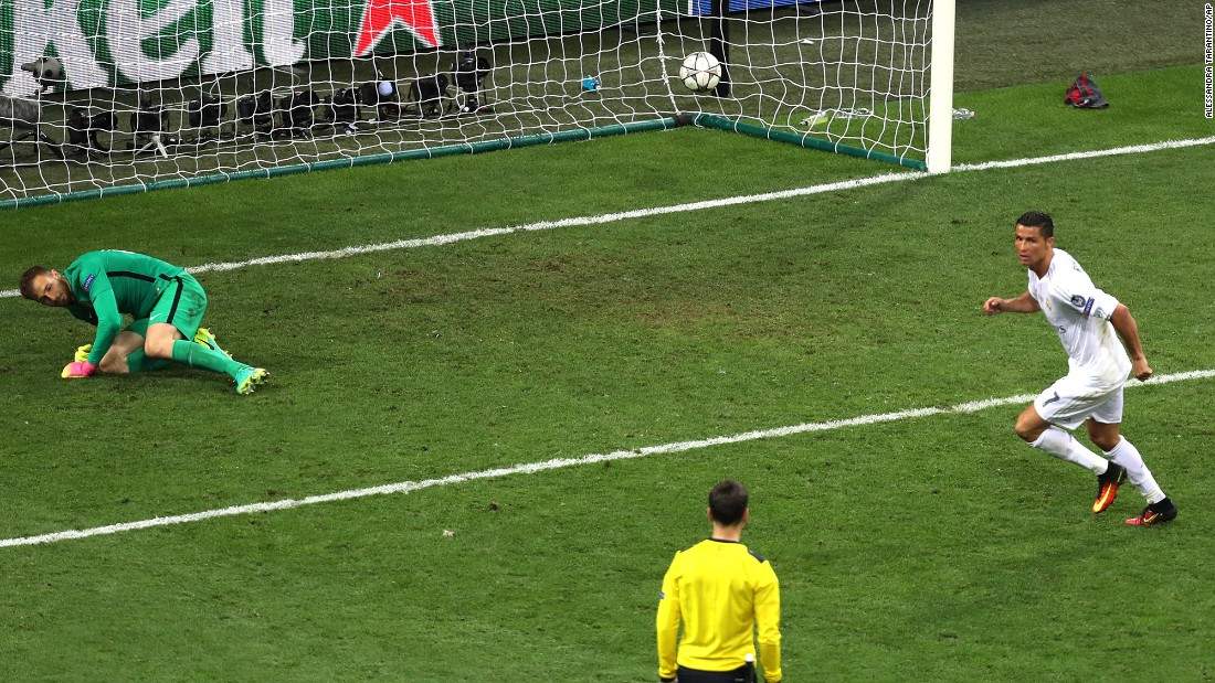 Real Madrid's Ronaldo scores the decisive penalty kick to win the Champions League final soccer match.