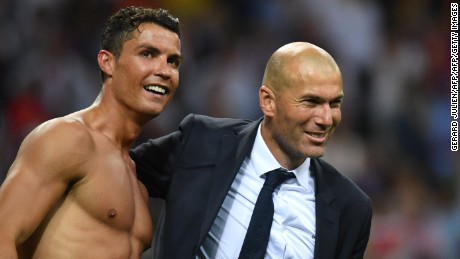 Real coach Zinedine Zidane celebrates with Ronaldo after sealing victory.
