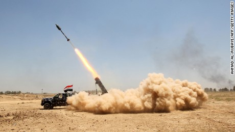 Pro-government forces fire on ISIS positions in al-Sejar, Iraq, near Falluja on Friday, May 27.