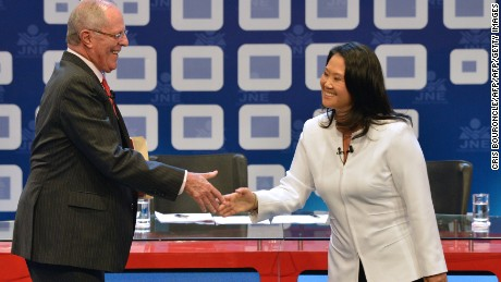 "Peruvian presidential candidate for the Fuerza Popular (Popular Strength) party Keiko Fujimori (R) shakes hands with Peruvian presidential candidate Pedro Pablo Kuczynski of the ""Peruanos por el Kambio"" (Peruvians for change) party before a televised debate in Lima on May 29, 2016.   Fujimori and Kuczynski will compete in Peru's June 5 runoff election. / AFP / CRIS BOURONCLE        (Photo credit should read CRIS BOURONCLE/AFP/Getty Images)"