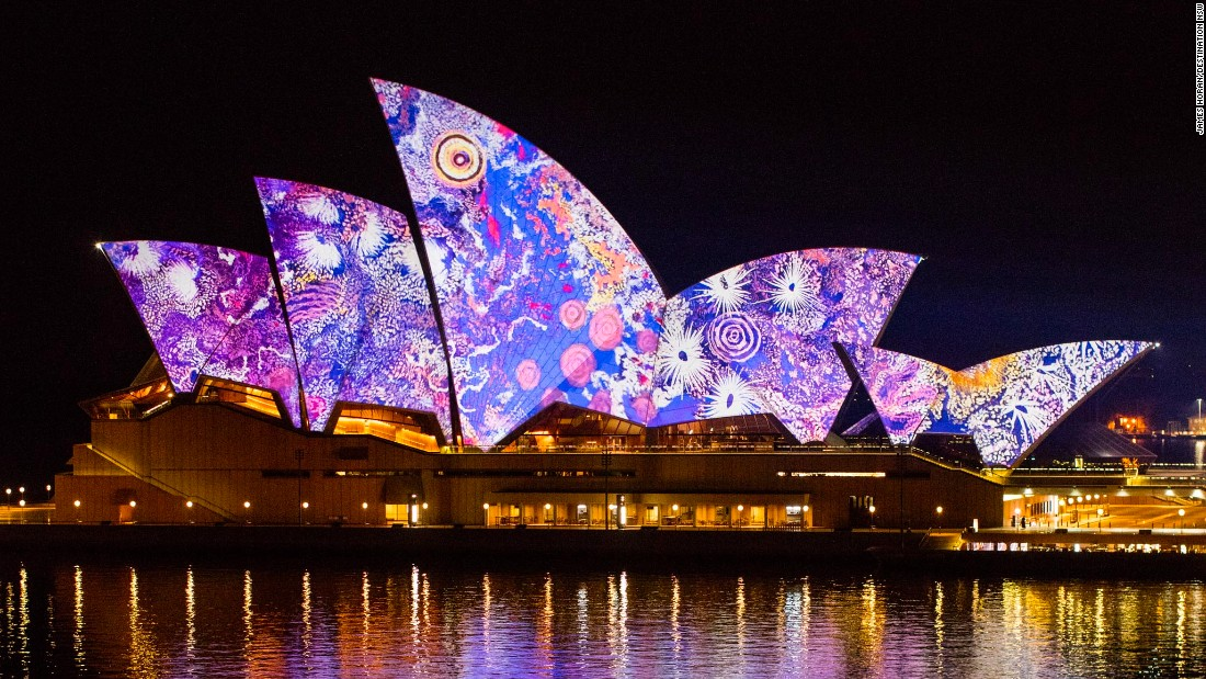 """Artist Gabriella Possum Nungurrayi transforms the """"sails"""" of Sydney Opera House as part of the """"Songlines"""" exhibition featuring contemporary works by indigenous artists."""