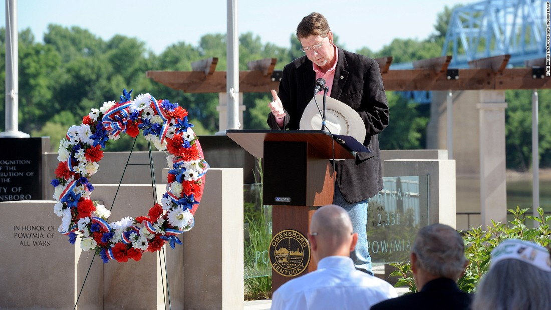 Daviess County Sheriff Keith Cain leads a prayer May 30 at the Charles Shelton Memorial in Owensboro, Kentucky.