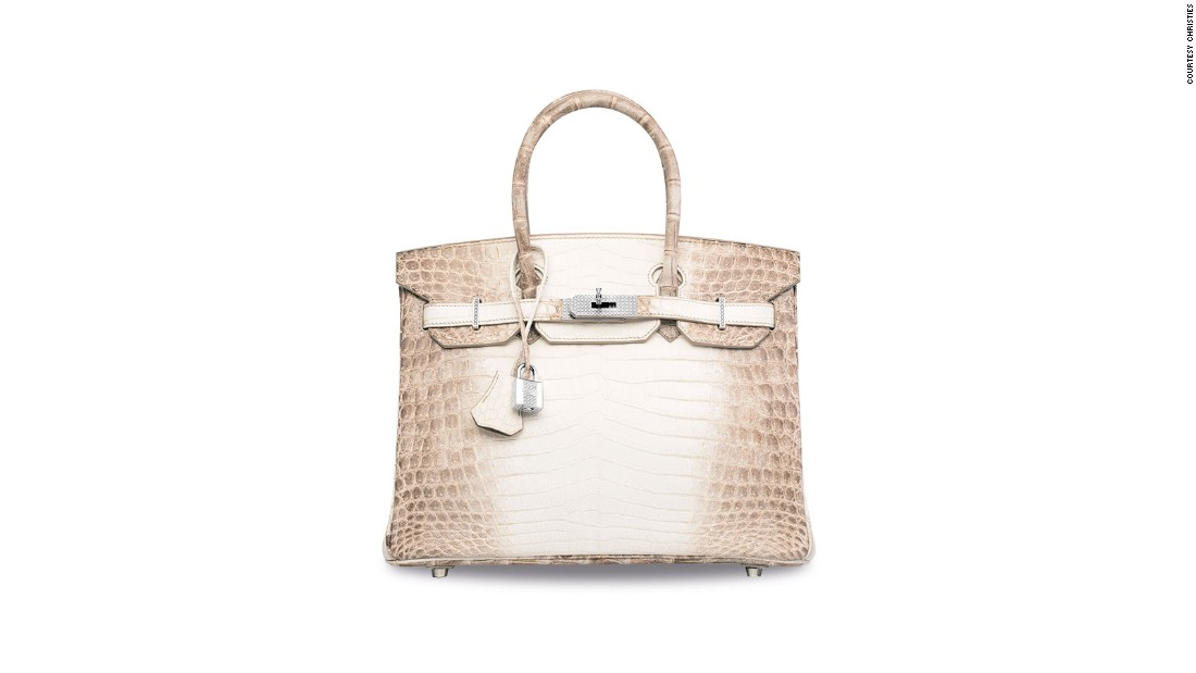 This Hermes signature Birkin is made with white matte Himalayan crocodile leather, and features hardware made from 18k white gold and diamonds. It sold for $300,168, making it the most expensive handbag ever sold.