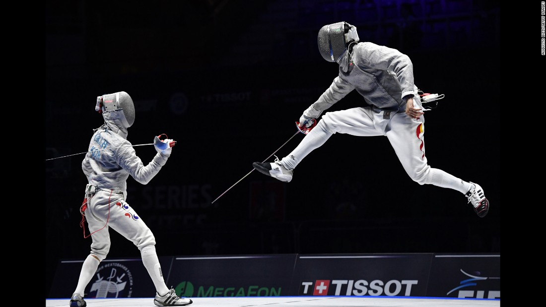 Chinese fencer Yingming Xu, right, competes against South Korea's Kim Jung-hwan in the Moscow Grand Prix's sabre final on Saturday, May 28. Kim won 15-7.