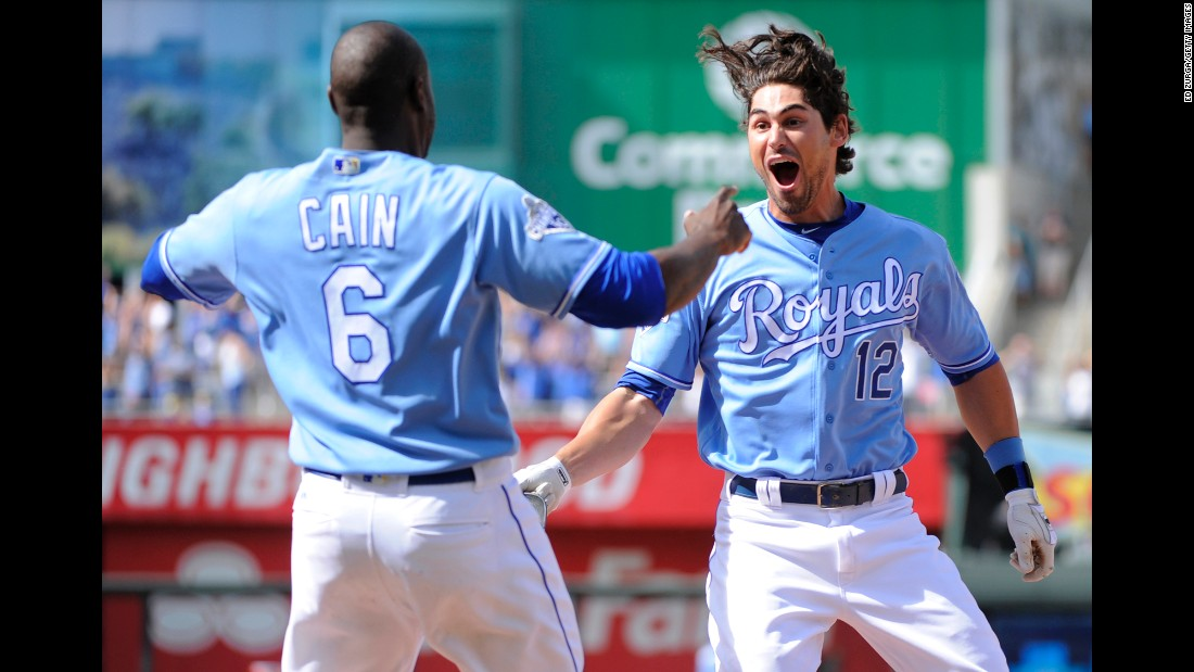 Lorenzo Cain and Brett Eibner celebrate after Eibner hit a game-winning RBI for the Kansas City Royals on Saturday, May 28.