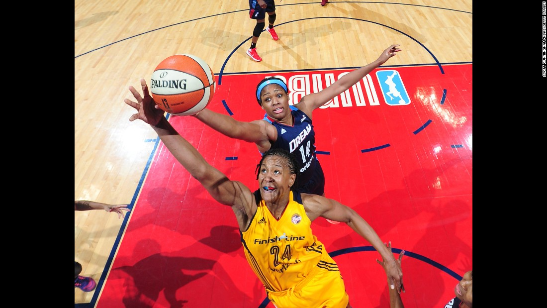 Indiana's Tamika Catchings, front, and Atlanta's Rachel Hollivay reach for a rebound during a WNBA game in Atlanta on Sunday, May 29.