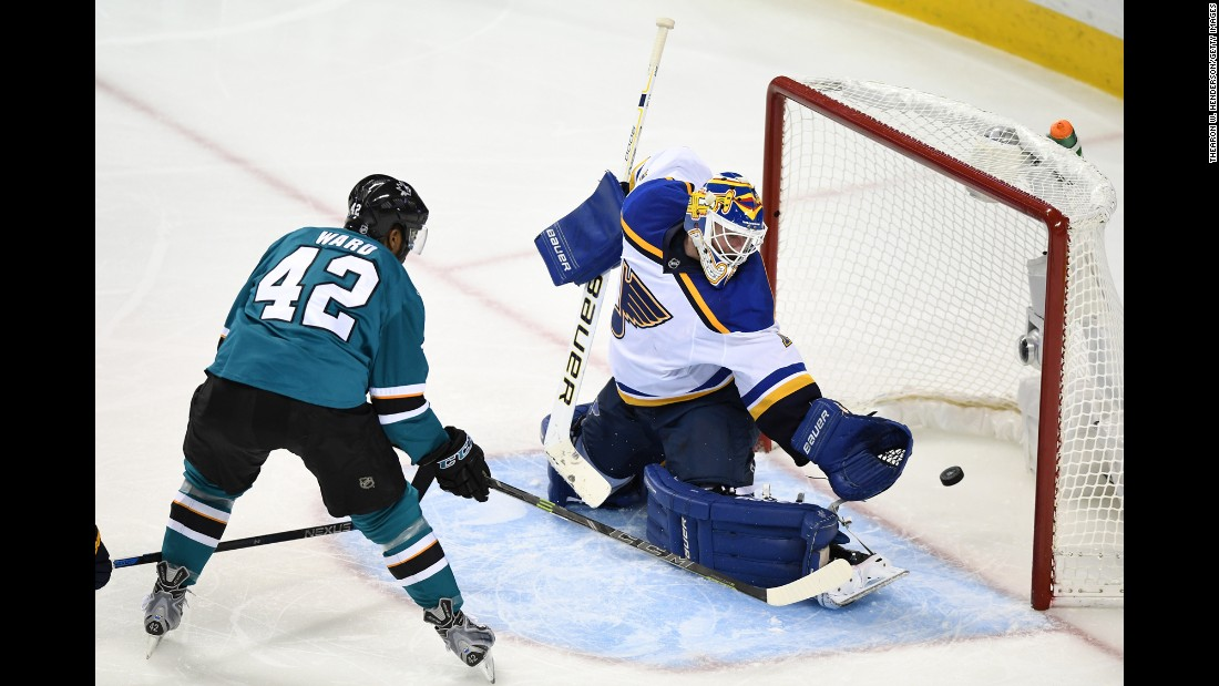 San Jose's Joel Ward slips the puck past St. Louis' Brian Eliott during Game 6 of the NHL's Western Conference Final on Wednesday, May 25. Ward had two goals in the series-clinching game, a 5-2 Sharks victory.