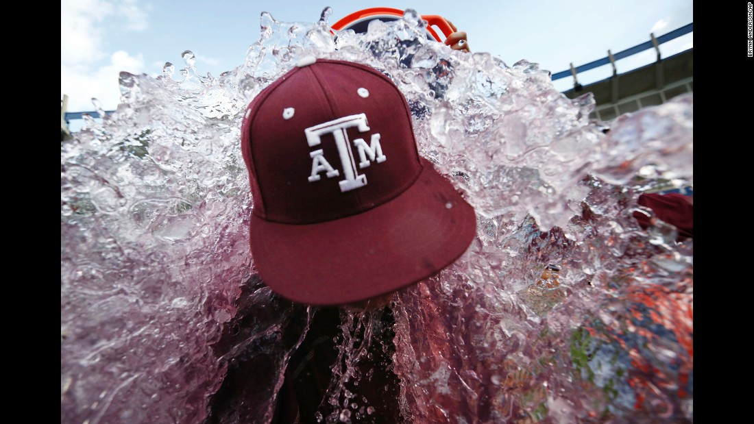 Texas A&M head coach Rob Childress is doused by his players after they won the SEC baseball tournament on Sunday, May 29.