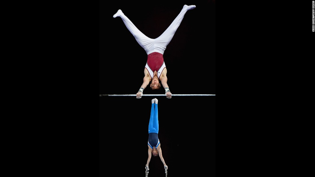 Kurt Grumelart, foreground, competes on the high bar as Alexander Waro competes on the parallel bars at the Australian Gymnastics Championships on Tuesday, May 24.