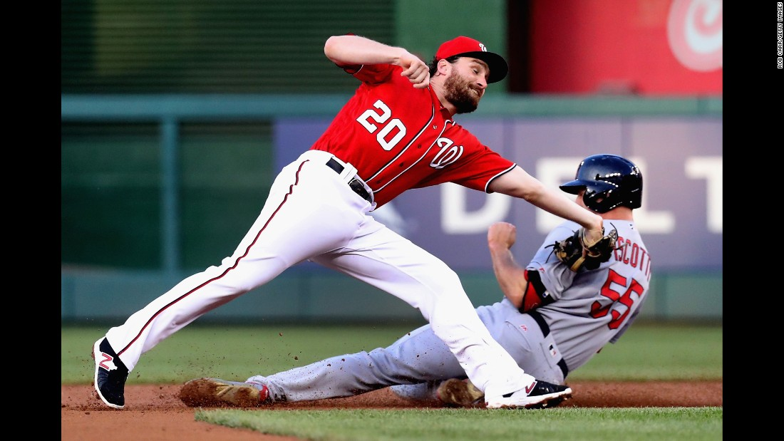 St. Louis' Stephen Piscotty steals second base, avoiding the tag of Washington's Daniel Murphy on Saturday, May 28.