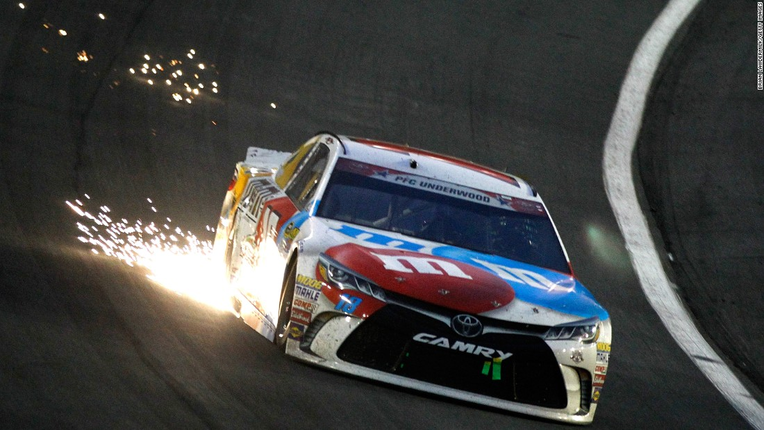 Sparks fly from the car of Sprint Cup driver Kyle Busch during the Coca-Cola 600 on Sunday, May 29.