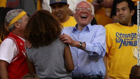 OAKLAND, CA - MAY 30:  Democratic presidential candidate Bernie Sanders greets fans at Game Seven of the Western Conference Finals between the Golden State Warriors and the Oklahoma City Thunder during the 2016 NBA Playoffs at ORACLE Arena on May 30, 2016 in Oakland, California. NOTE TO USER: User expressly acknowledges and agrees that, by downloading and or using this photograph, User is consenting to the terms and conditions of the Getty Images License Agreement.  (Photo by Ezra Shaw/Getty Images)