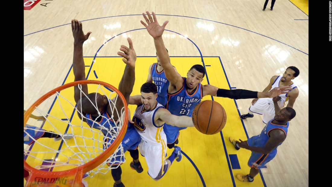 Golden State's Klay Thompson shoots between Oklahoma City's Serge Ibaka, left, and Andre Roberson during Game 7 of the NBA's Western Conference Finals on Monday, May 30. The Warriors won 96-88, overcoming a 3-1 series deficit, and they will advance to the NBA Finals for a rematch with the Cleveland Cavaliers. The Warriors defeated Cleveland last year for the NBA title.