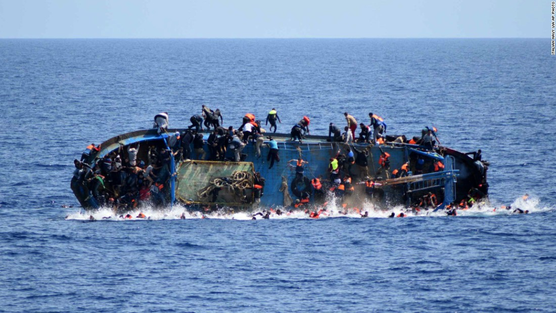 "A ship crowded with migrants <a href=""http://www.cnn.com/2016/05/25/middleeast/migrant-ship-overturns/"" target=""_blank"">flips onto its side</a> Wednesday, May 25, as an Italian navy ship approaches off the coach of Libya. Passengers had rushed to the port side, a shift in weight that proved too much. Five people died and more than 500 were rescued."