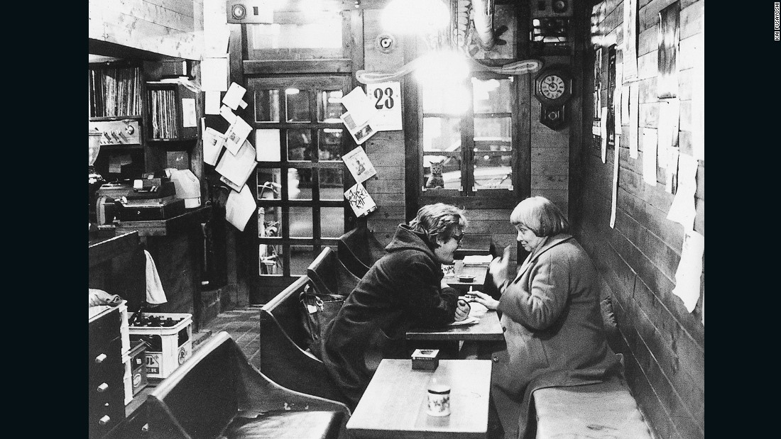 """Nicola Geiger (right) had a strong personality and was loved by everyone,"" said Fusayoshi. ""Her father was the inventor of the Geiger counter, which detects radiation levels, and she retired and came to work with us at the cafe.  In this photo she was encouraging a Polish nuclear scientist to return to the country despite the risk of imprisonment."""