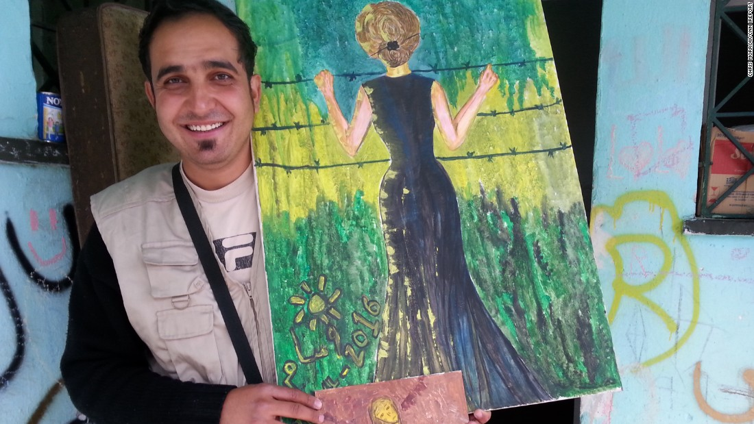Ali carries oil paintings from his sister, Wasim, like this one of a woman standing at a barbed-wire fence.