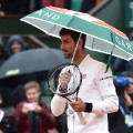 Novak Djokovic umbrella french open day 10
