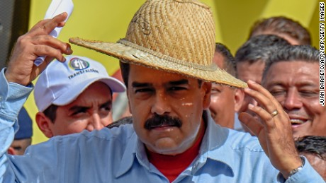 "Venezuelan President Nicolas Maduro wears a hat during a rally in Caracas on May 31, 2016. Venezuelan President Nicolas Maduro called for a ""national rebellion"" against alleged international threats Tuesday and told the head of the Organization of American States to ""shove it"" in an escalating war of words. / AFP / JUAN BARRETO        (Photo credit should read JUAN BARRETO/AFP/Getty Images)"