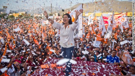 TOPSHOT - Peruvian presidential candidate for the Fuerza Popular (Popular Force) party and daughter of imprisoned former Peruvian President (1990-2000) Alberto Fujimori, Keiko Fujimori, waves during a rally in Lima on May 31, 2016. Fujimori leads the polls for next May 5 presidential elections in Peru.  / AFP / ERNESTO BENAVIDES        (Photo credit should read ERNESTO BENAVIDES/AFP/Getty Images)