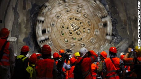 A giant drilling machine completes the tunnel beneath the Swiss Alps during a ceremony in October 2010.