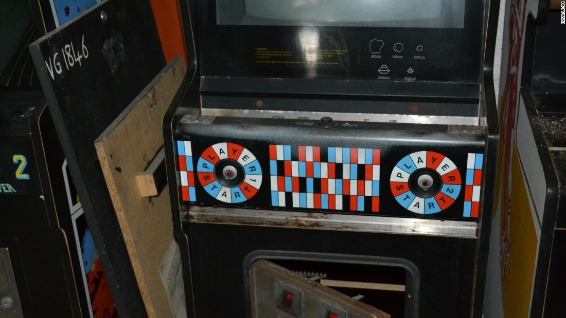 Colorful front display of an old two player arcade machine.  One can only guess at the fun each player must have had playing on this very vintage of arcade machines.