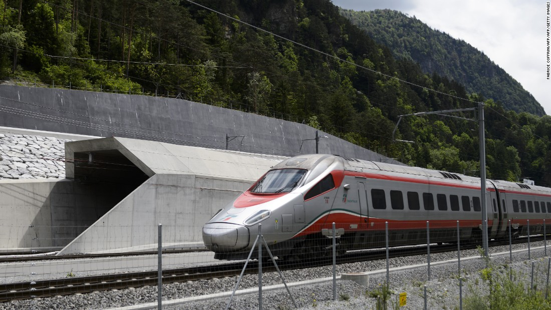 Regular rail service began in December 2016 through Switzerland's Gotthard Base Tunnel, the world's longest and deepest tunnel. It runs beneath the Swiss Alps. Pictured: An Italian train at the tunnel's northern entrance on the eve of the tunnel's June opening ceremony. <strong>Length: </strong>57 kilometers.