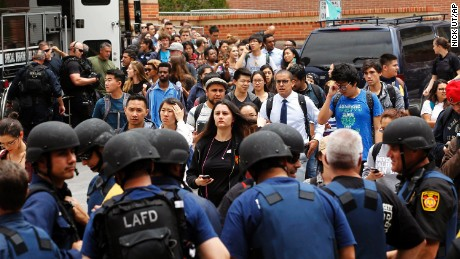UCLA students gather on the campus near the scene of a fatal shooting at the University of California, Los Angeles, Wednesday, June 1, 2016, in Los Angeles. (AP Photo/Nick Ut)