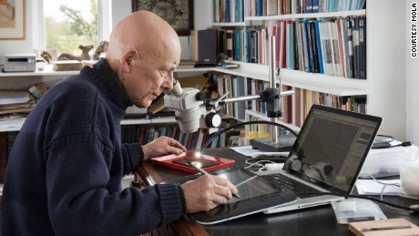 Dr Roger Tomlin deciphers a writing tablet.