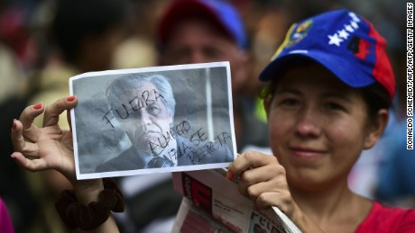 "Supporters of Venezuelan President Nicolas Maduro take part in a protest against the Organization of American States (OAS) and its Secretary General Luis Almagro, in Caracas, on June 01, 2016.  As part of an escalating war of words, Maduro on the eve told the head of the Washington-based organization to ""shove it."" The verbal barrage came after Almagro called for an urgent meeting on the Venezuelan crisis, warning democracy was at risk in the country.  / AFP PHOTO / RONALDO SCHEMIDTRONALDO SCHEMIDT/AFP/Getty Images"