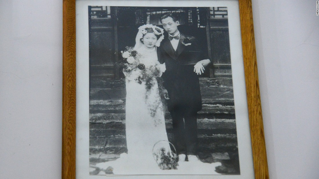 "Liu's inlaws lived inside this building before they passed away. The couple came from wealthy families and were persecuted during the Cultural Revolution. This wedding photo, taken in the early 1940s and hanging on the wall of their room, is the only one that survived the Cultural Revolution, when a Western-style wedding photo would be destroyed because it was ""bourgeois."""