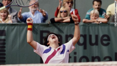 Sanchez Vicario throws her racquet into the air after winning  the Women's French Open  in 1989.