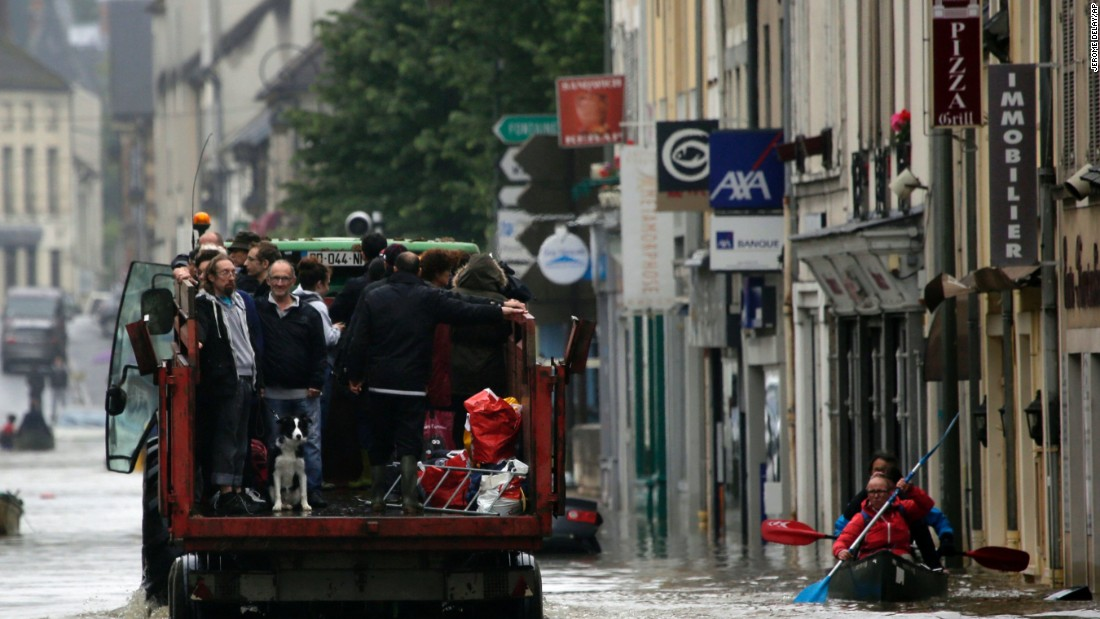 Residents are evacuated from their homes in Nemours on June 2. Water from the Loing River flooded the streets of the French town.