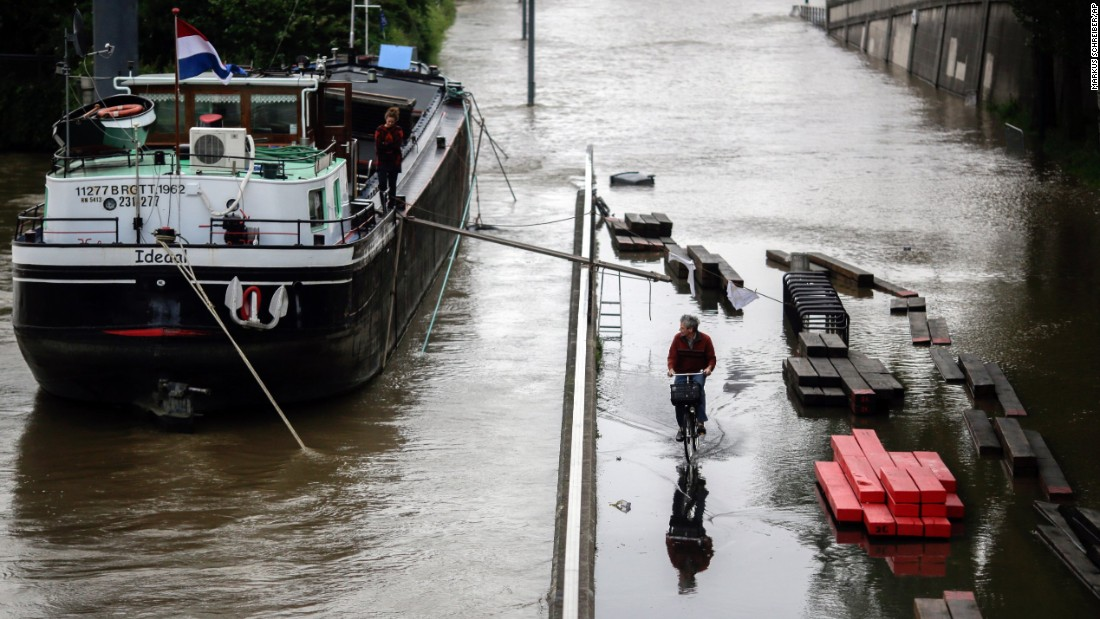 A man rides a bike through a Paris street flooded by the Seine on June 2.