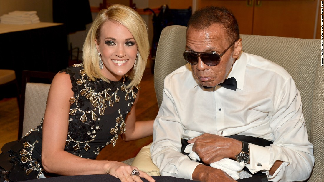 Ali is seen with singer Carrie Underwood at a charity event in Phoenix in April.
